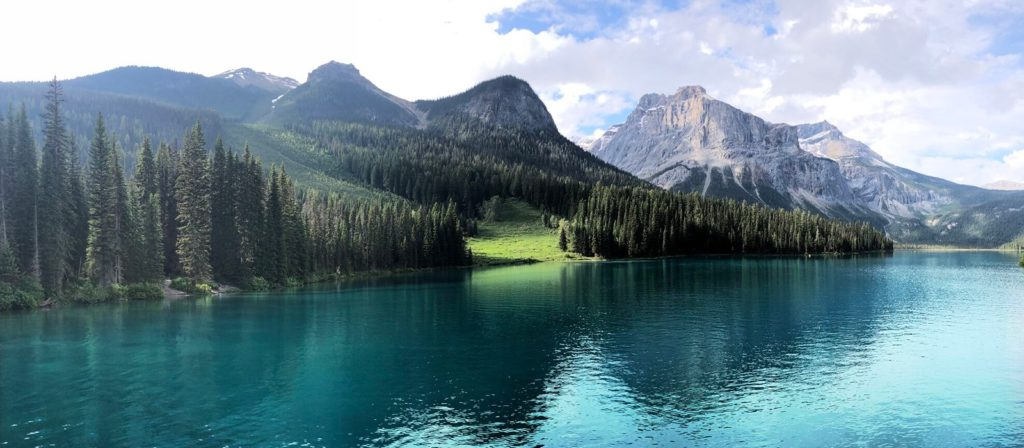 A beautiful scene of a lake with tree and mountain landscape