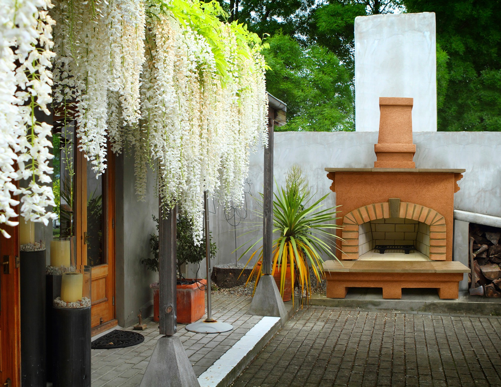 A photo of a tropical environment outdoor patio with a fire place